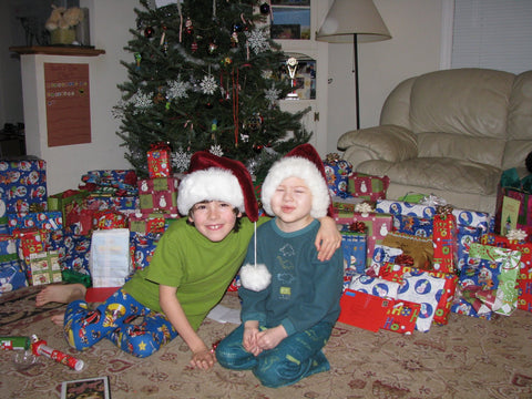 two boys at christmas one has leukemia and is sick