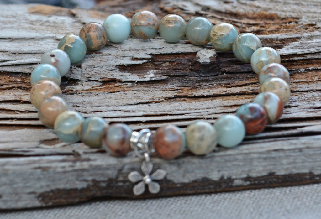 sterling silver flower charm on blue stretch gemstone bracelet by Butterfly Warriors