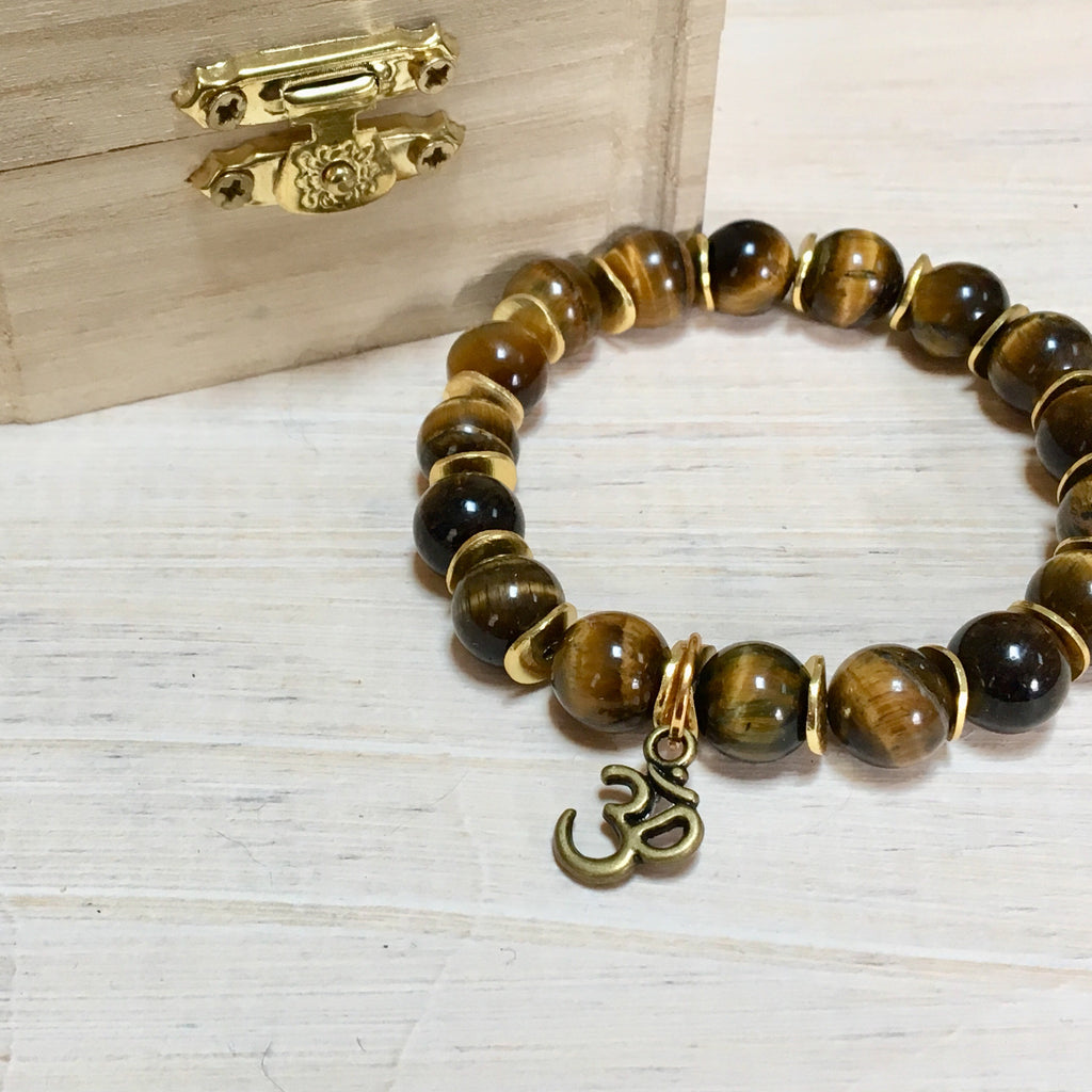 gift box with tigers eye stretch bracelet om charm