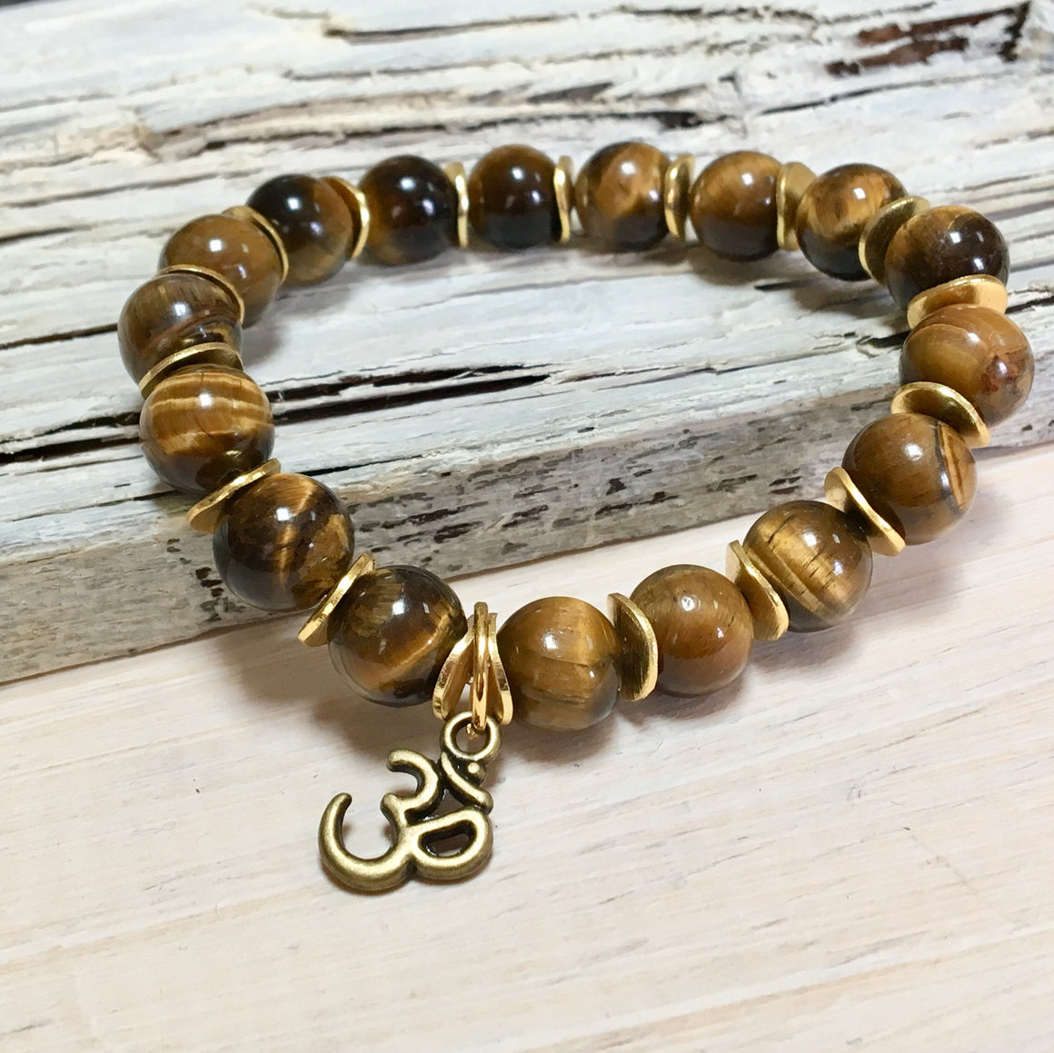 stretch tiger's eye jewelry with yoga om charm