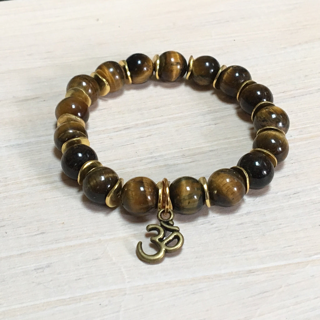 stretch gemstone tigers eye with gold and ohm charm
