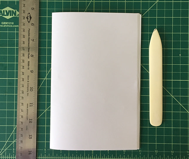 folding papers with a bond folder