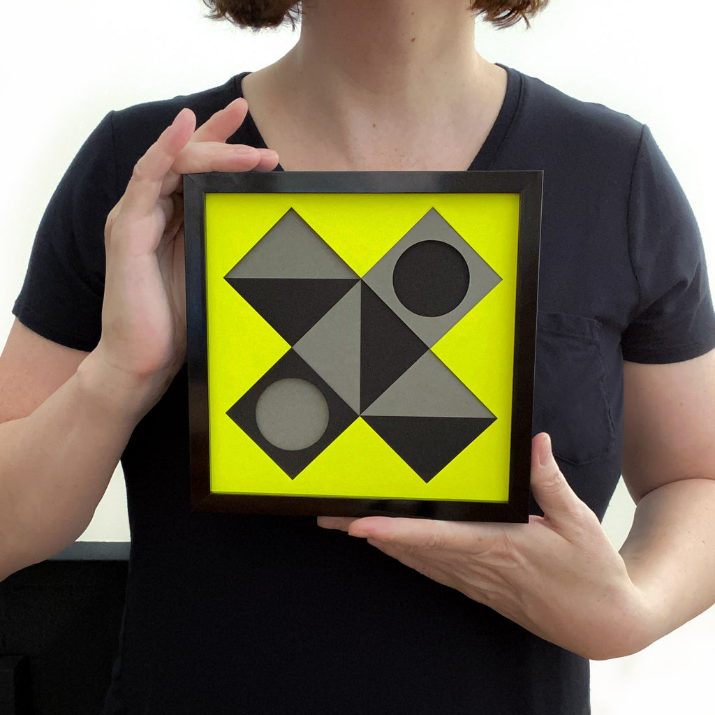 Yellow X framed held