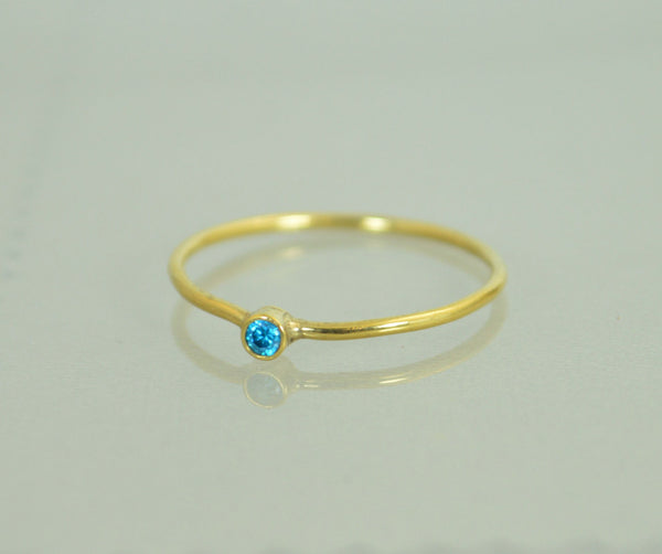 Tiny Solid Gold Blue Zircon Ring