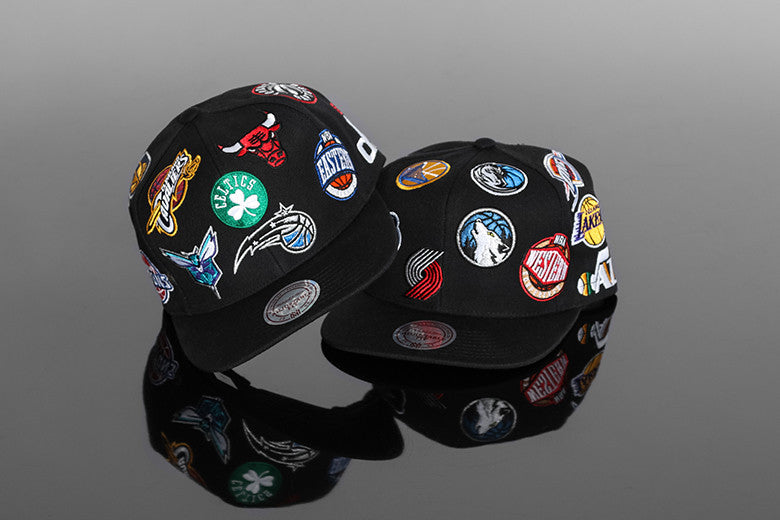 Mitchell & Ness East/West All Over Snapbacks
