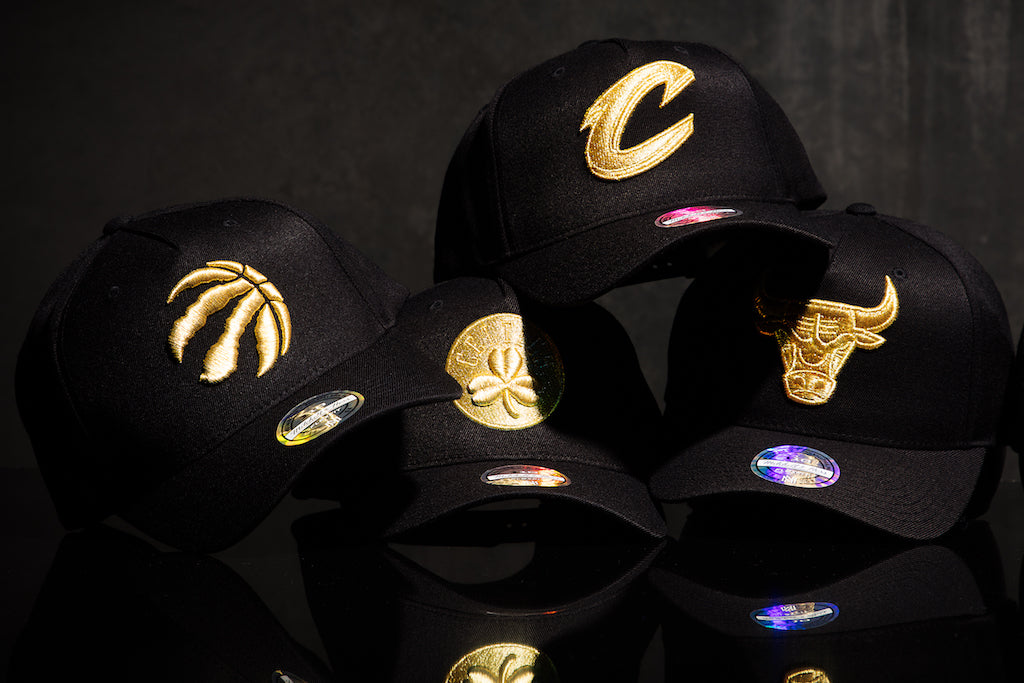 Mitchell   Ness are at it again and have stepped up the luxe with the new  110 Pinch Snapback in black and gold. Releasing on Monday 19 March 6f10a31672ec