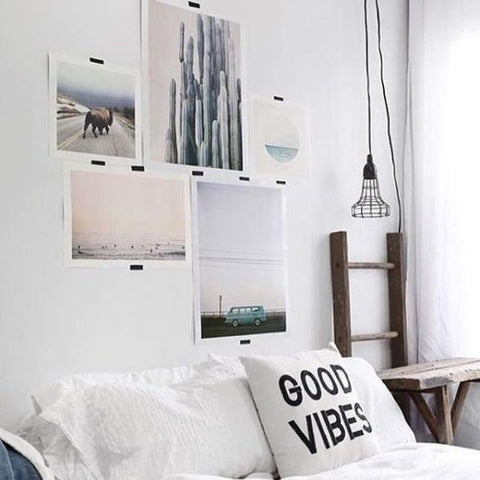 Hang prints with washi tape bedroom on a budget from Apartment Therapy