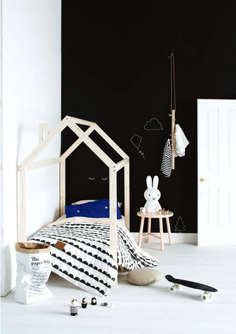 New Zealand Design blog black wall and white house bed