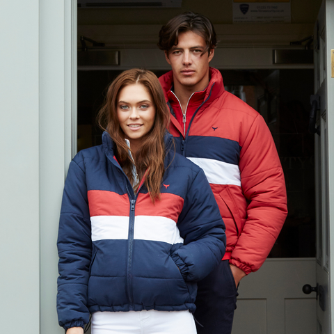 Guy and girl models both in navy and red striped puffer jackets