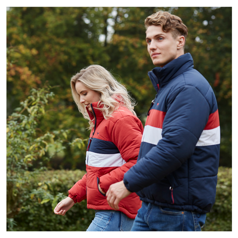 Girl and guy wearing navy and red striped puffer jackets