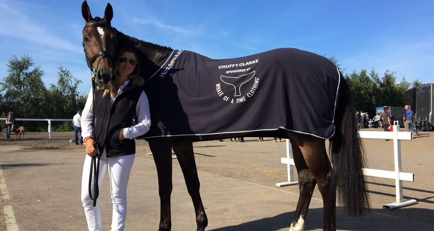 Chuffy Clarke with her horse which is wearing a sponsored by Whale Of A Time Clothing rug