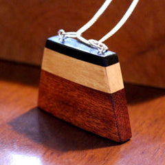 Tri-wood pendant with silver chain