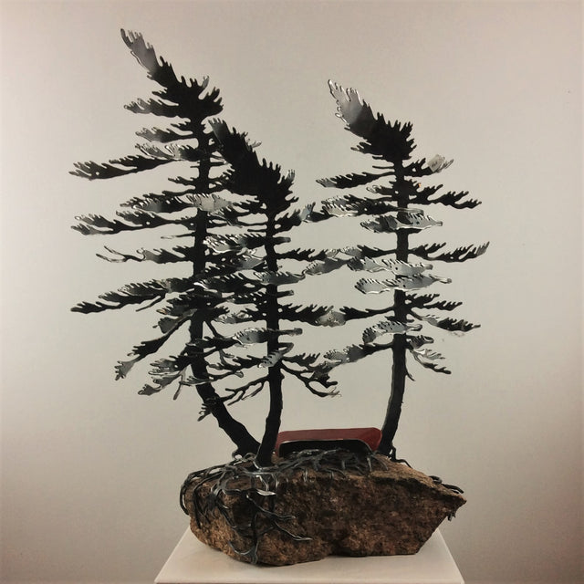 Steel Triple Tree Sculpture with Canoe on Canadian Rock