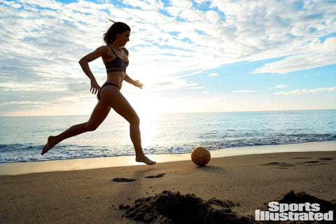Alex Morgan was photographed by Ben Watts in St. Lucia for Sports Illustrated. Swimsuit by Pistol Panties