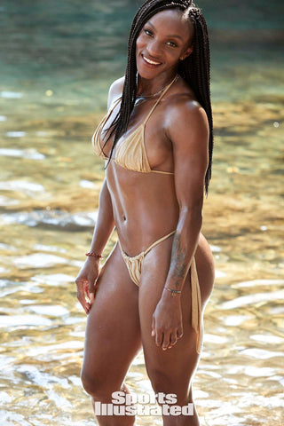 Crystal Dunn was photographed by Ben Watts in St. Lucia for Sports Illustrated. Swimsuit by Pistol Panties by Deborah Fleming