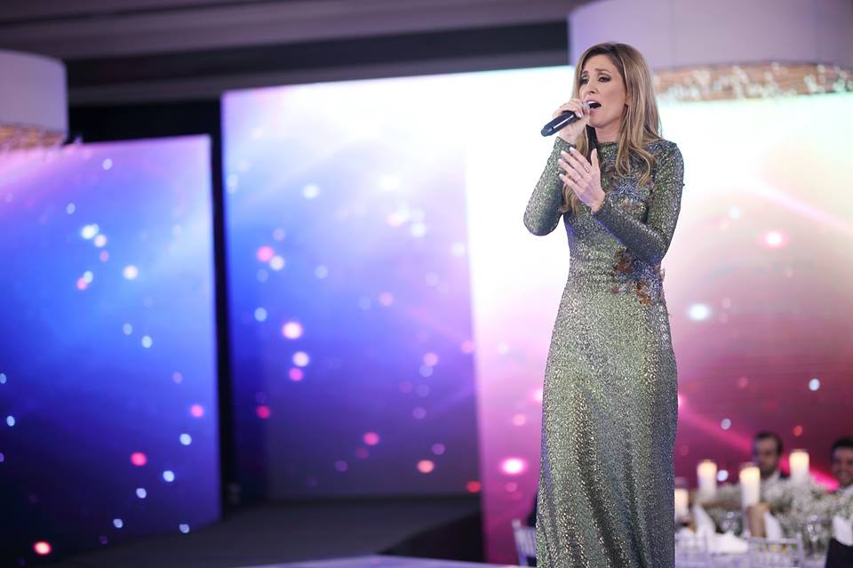 Kelly Levesque performs, KNOWAutism Gala, Miles David Gown, David Peck custom gown
