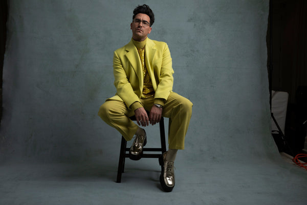 Dan Levy in Valentino Couture and Cartier jewelry
