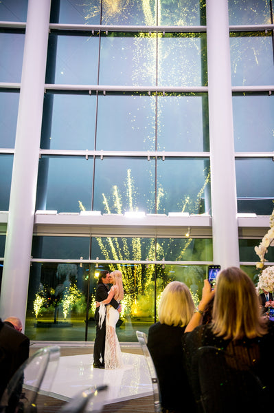 Amy West and Gary Becker wedding at Smart Financial Center in Sugarland, Custom gown by David Peck.