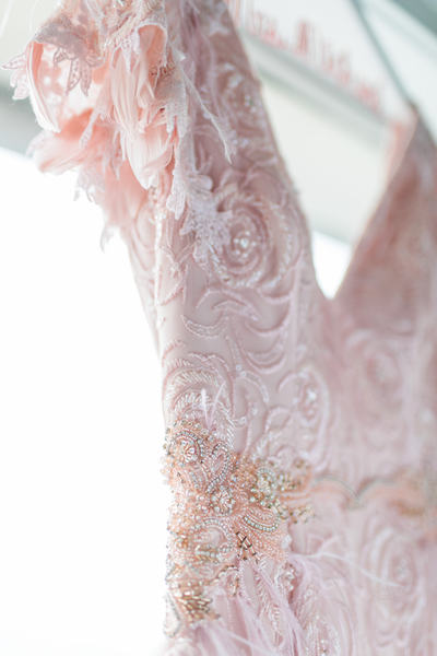 Blush pink lace and feather sleeves on a custom gown for an elopement at the Fairmont San Francisco