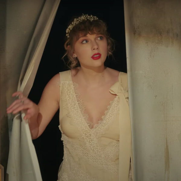 Taylor Swift in a tiara for her willow video david peck is a designer in Houston texas who sells tiaras for weddings