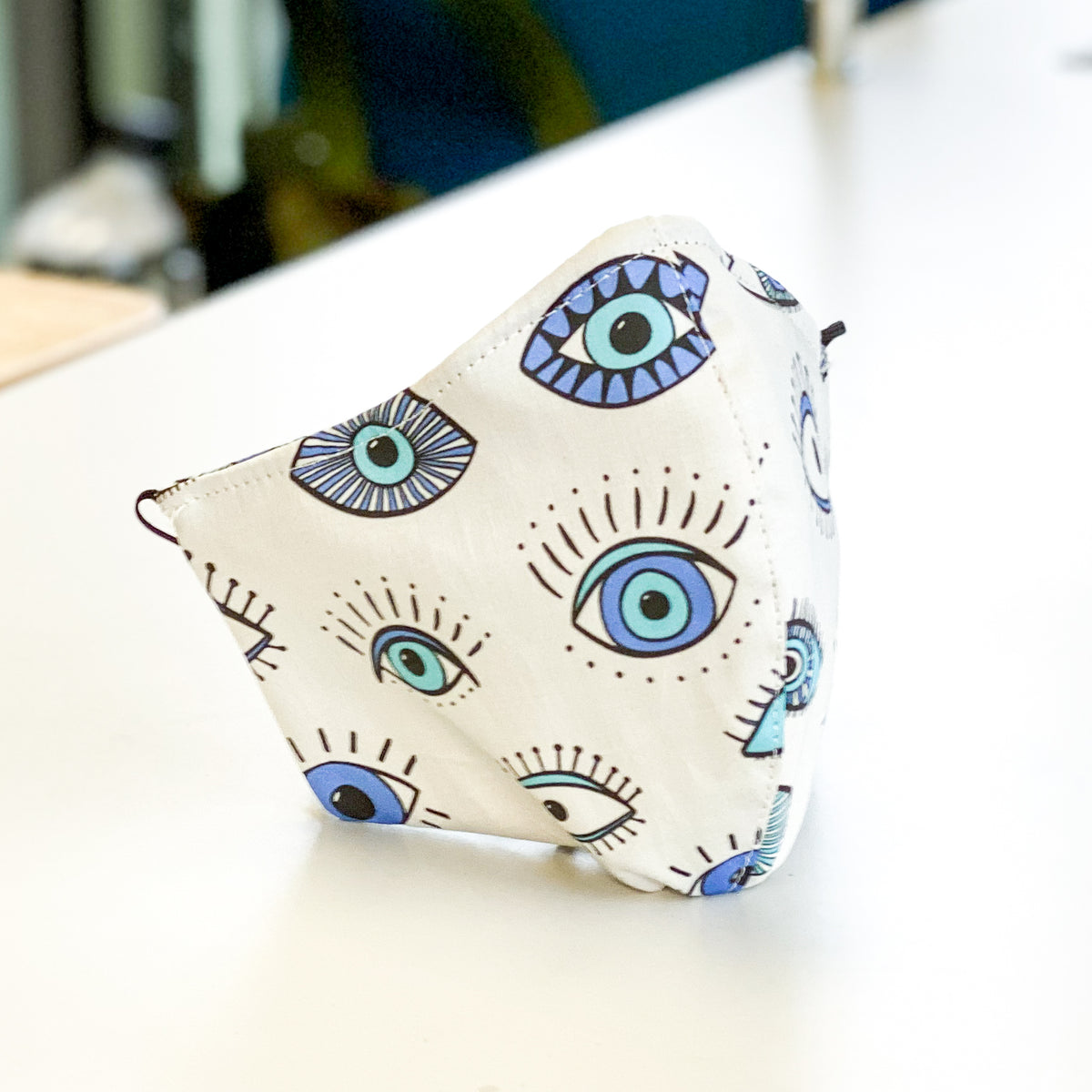 Coronavirus mask with eye doctor and evil eye theme print by David Peck