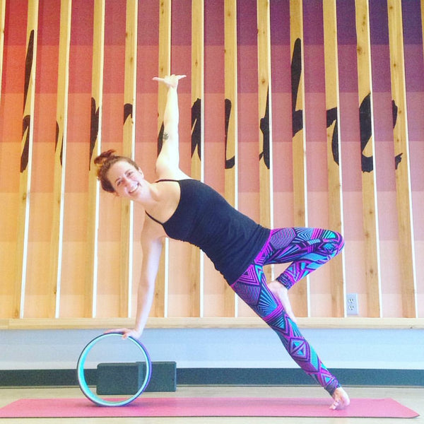 7 Great Ways to Use a Yoga Wheel