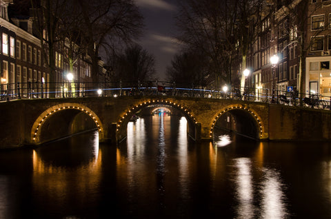An Amsterdam canal at night.
