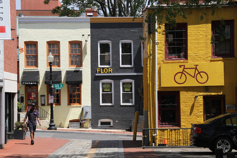A row of colorful buildings and cool businesses in Georgetown, Washington DC.