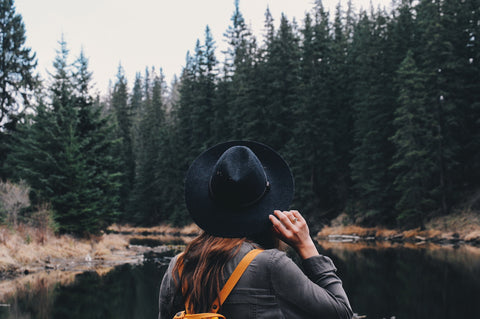 A woman hanging out in the woods.