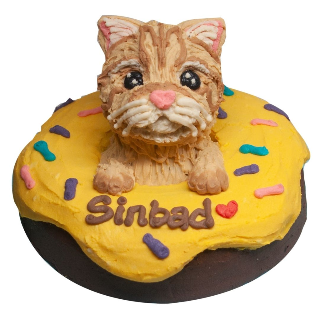 donut cake with cat topper