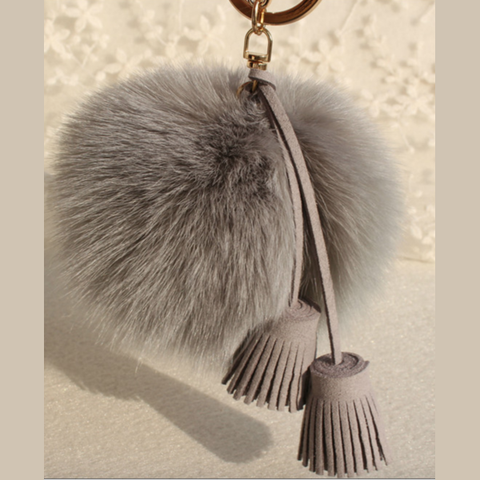Pom Pom Charm in Gray with Suede Tassels