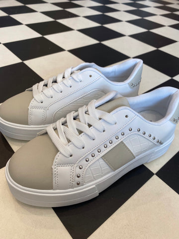 White trainer with stud detail