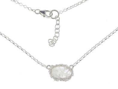 Faceted moonstone pendant set in pure silver mesh on sterling silver chain
