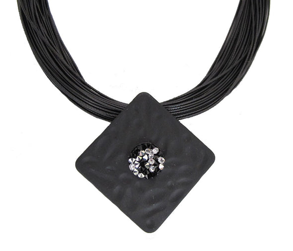 Black multi strand necklace with square pendant set with swarovski crystal rock