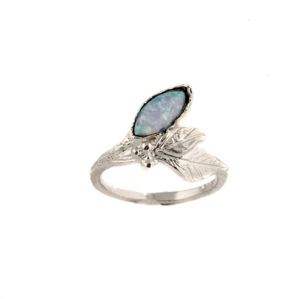 Sterling silver dainty ring with marquise shaped blue opal stone handcrafted in Israel