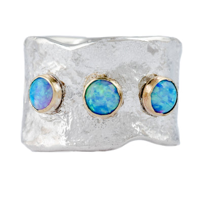 Testured sterling silver band set with blue opals and trimmed in gold