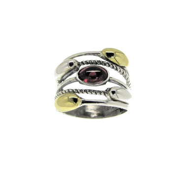 Sterling silver and gold ring set with garnet stone/  Stackable looking ring of five rings but it's all in one.