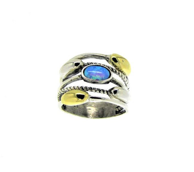 Sterling silver and gold ring with blue opal.  Looks like a stackable ring of five rings but it's all in one