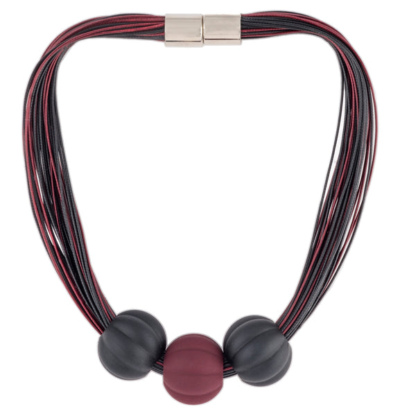 Multistrand necklace in red and black with magnet clasp.  Three senter balls adorn ncklace