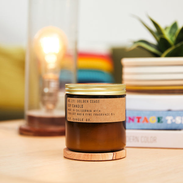 PF Candle Co Golden Coast large scented soy wax candle inspired by Big Sur magic, wild sage baking in the sun, the rumble of waves and rocks with scent notes of eucalyptus, sea salt, redwood, and palo santo