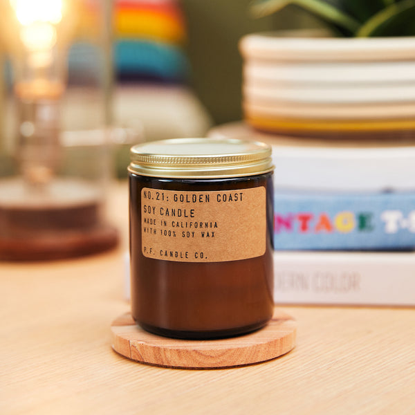 PF Candle Co Golden Coast scented soy wax candle inspired by Big Sur magic, wild sage baking in the sun, the rumble of waves and rocks with scent notes of eucalyptus, sea salt, redwood, and palo santo