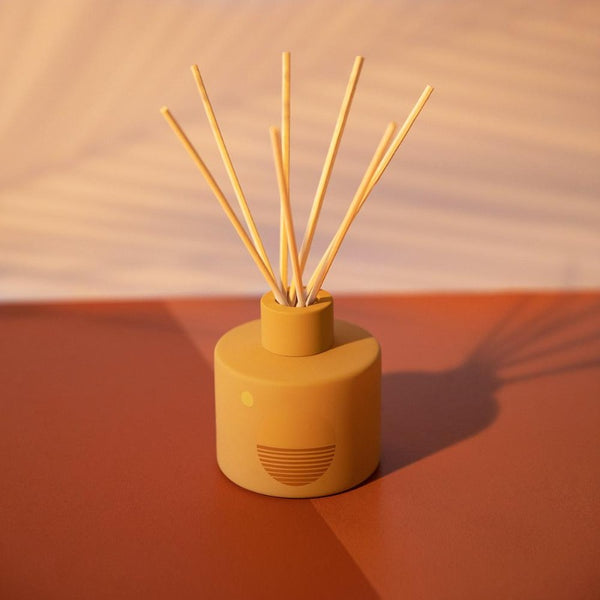 PF Candle Co Golden Hour Sunset Line glass bottle reed diffuser with rattan reed sticks inside