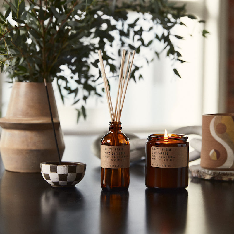 P.F. Candle Co. classic line scent Pinon inspired by Winters in the southwest, lingering bonfires, wool jackets in rotation