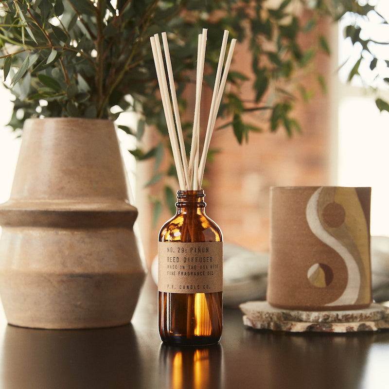 P.F. Candle Co. classic line Pinon scented reed diffuser with scent notes of piñon logs, cedar, and vanilla