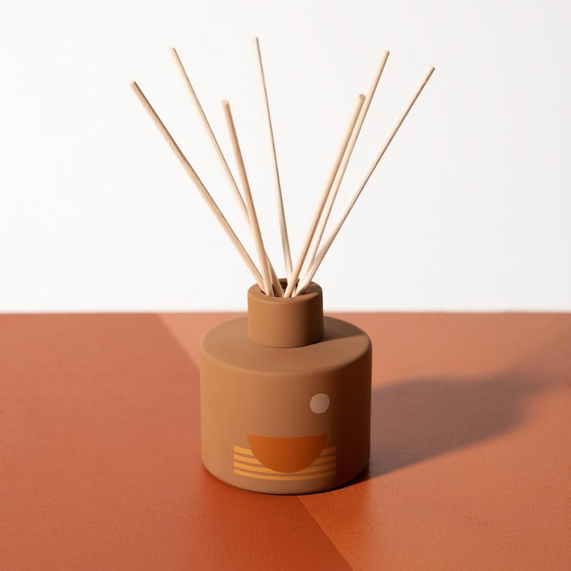 PF Candle Co Swell Sunset Line glass bottle reed diffuser with rattan reed sticks inside