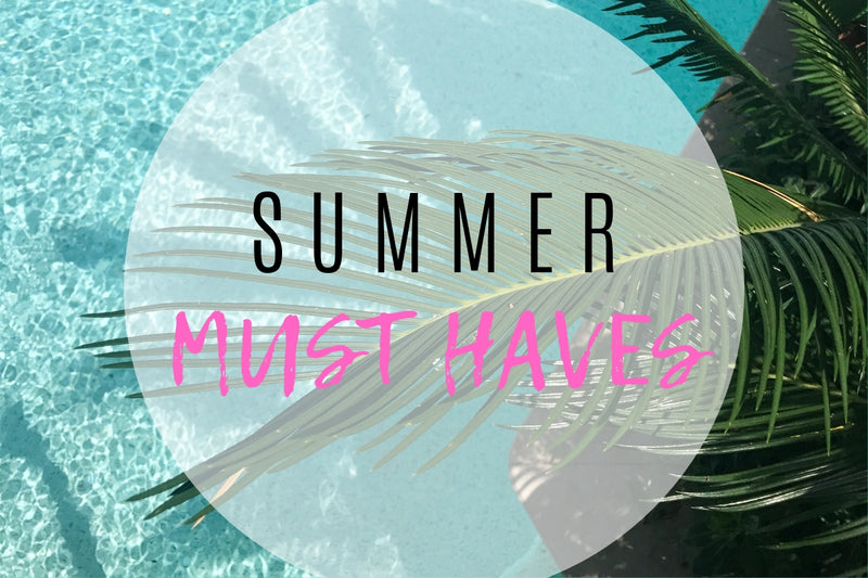 Palm trees and water with Summer Must Haves text