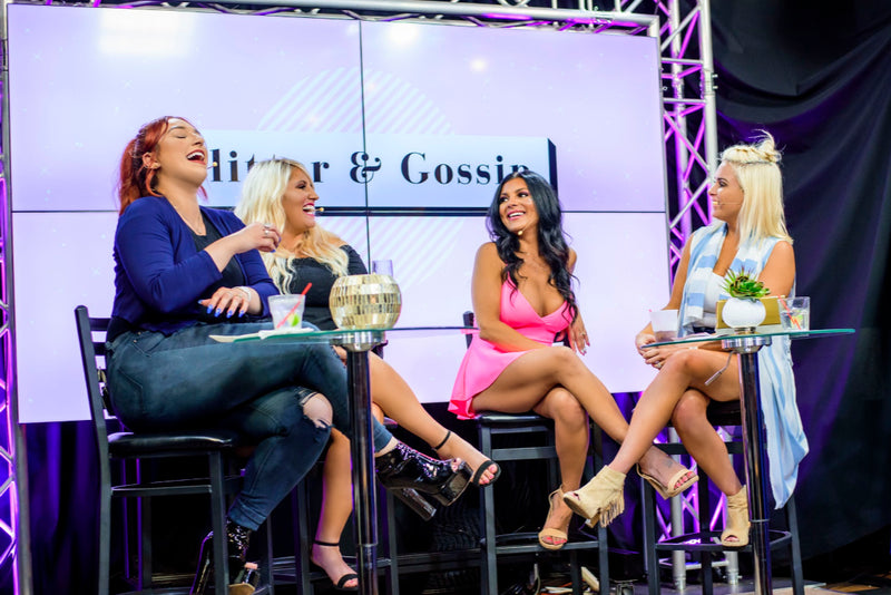 The four women from Glitter & Gossip television show on set during the show filming