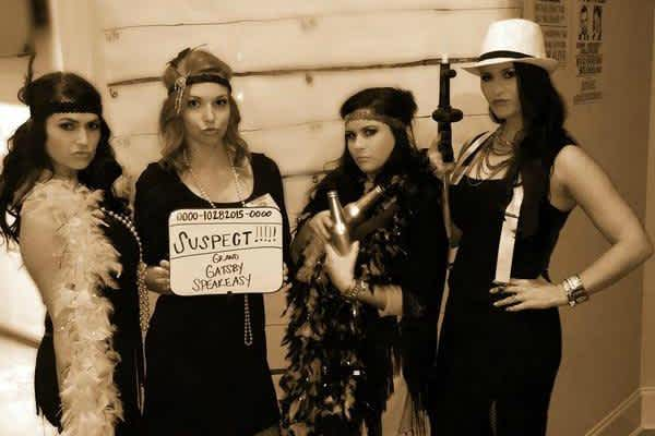 Flapper costumes with women posing