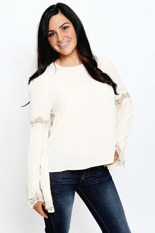 model wearing light pink long sleeve top with crochet details