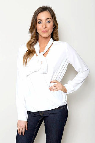 model wearing white long sleeve top with neck tie detail